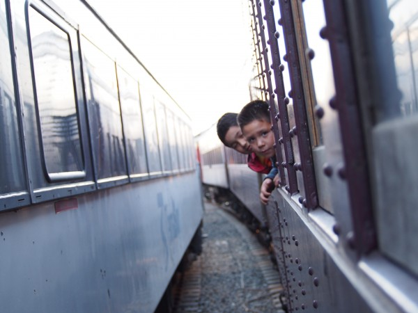 kids hanging out of train
